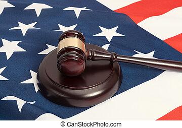 Judge gavel and soundboard laying over USA flag - Studio...