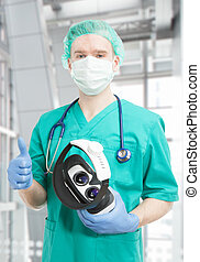 Doctor with VR glasses in hangs - indoors shot - Doctor with...