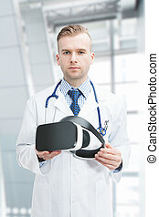 Indoors close up shot of doctor wearing VR glasses - Indoors...