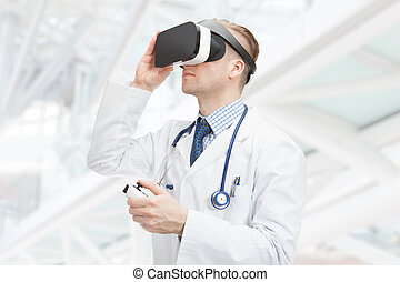 Indoors close up shot of male doctor wearing VR glasses -...