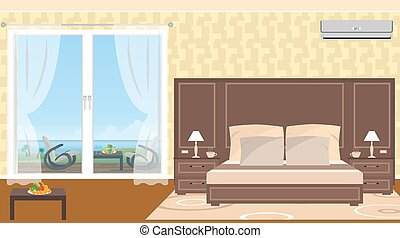 The interior of resort hotel room with outlet to sea and...