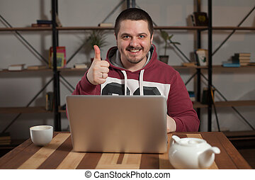 Happy man with laptop - Man shows that everything is okey at...