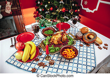 Christmas dinner by candlelight, table setting Thanksgiving...