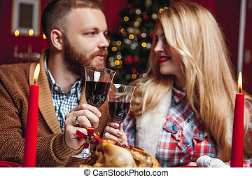 Beautiful couple in a decorated festive interior with a...