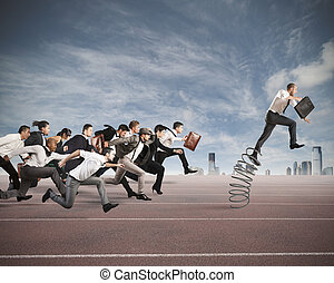 Overcome and achieve success - Businessman jumping on a...
