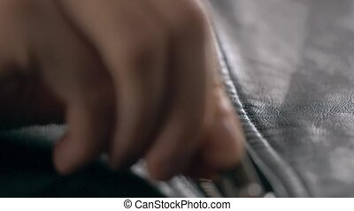 close up Opened zipper on man leather jacket - close up...