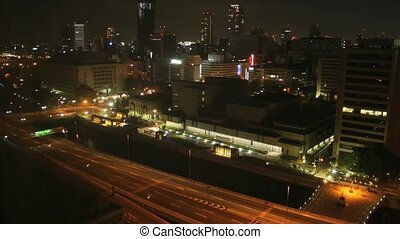 Time lapse Osaka streets and skyscrapers at night