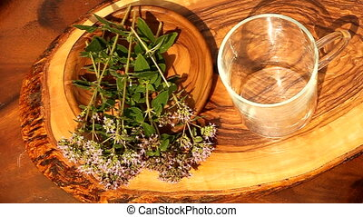 herbal tea - pouring herbal tea into cup
