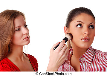 Two beautiful woman with brush for make-up