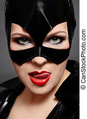 Catwoman - Portrait of sexy woman in catwoman black vinyl...