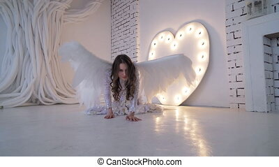 Girl in a white dress with wings and sneaks - The girl in a...