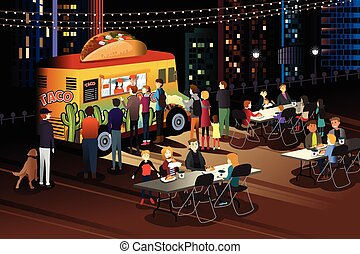 People Eating Taco at Taco Truck at Night