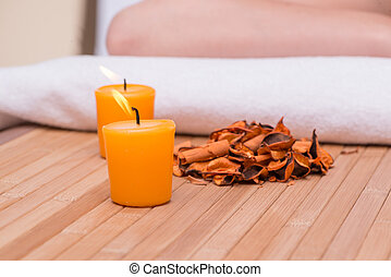 Spa concept with candles and dry leaves