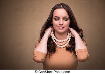 Young woman with pearl necklace