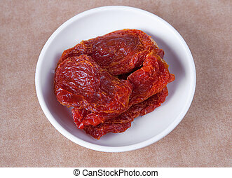 sundried tomatos - one small white bowl of sundried tomatos...