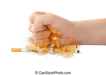 stop smoking - male fist with many cigarettes at fire...