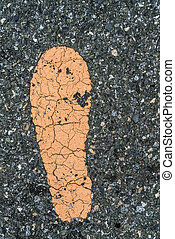 Foot step sign on asphalt texture