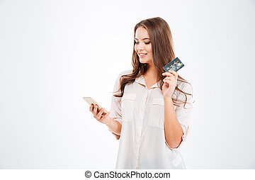 Happy woman holding bank card and tablet computer - Happy...