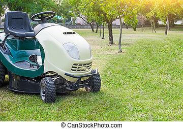 Lawn mower parked in a garden