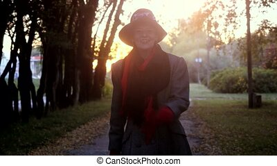 Mature elegant happy woman in age wears in coat and hat...