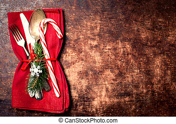 Christmas table place setting with christmas ornaments and...