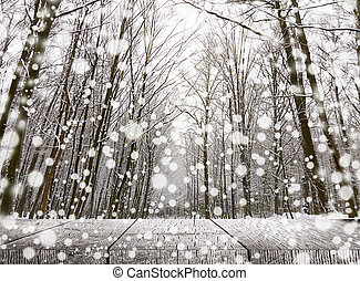 Wooden table over winter snow covered forest. Beauty nature...