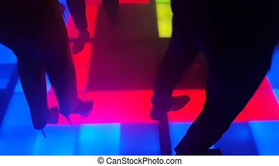 People dancing on the dance floor in nightclub