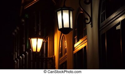 Vintage lights on the buildings in the old city of Riga