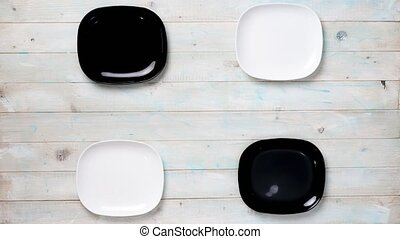 modern table setting with black and white plates and...