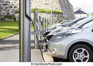 Electric car charging battery at the station