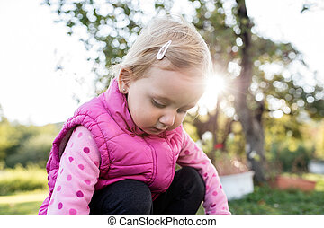 Cute little girl outside in nature on a sunny day - Cute...
