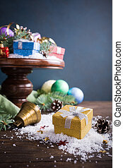 Gifts with christmas decoration on wooden cake stand....