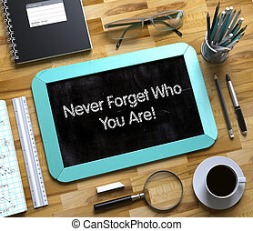 Never Forget Who You Are Concept on Small Chalkboard. 3D. -...