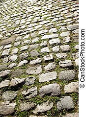Stone close up - Floor of a street with stone tiles.