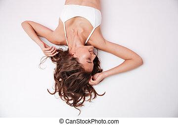 Beautiful young woman with long hair wearing white bikini -...