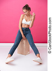 Funny pretty woman in white top and jeans posing - Full...