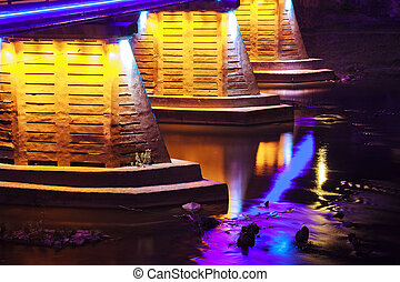 reflection in the water of illumination the bridge - Tyne...