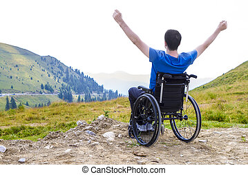 ptimistic handicapped man - Young man in a wheelchair...