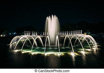 Fountains at the National World War II Memorial at night, at...