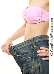 woman in large pant after losing weight - studio shot of...