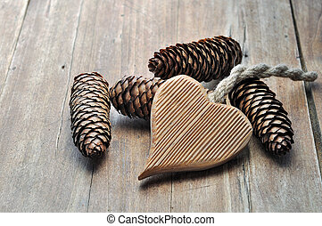 wooden heart shaped - wooden heart shaped and pine cones on...