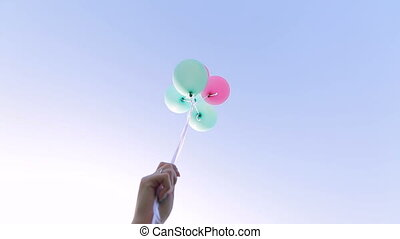 girl let go of balloons on sky background - girl let go of...