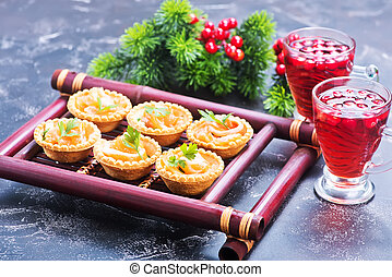 canape with red salmon on the bamboo tray