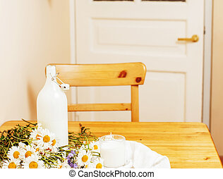 Simply stylish wooden kitchen with bottle of milk and glass...