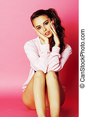 young pretty slim brunette modern woman on pink background...