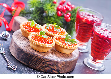 canape with red salmon caviar on the wooden board