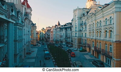 Aerial View of Buildings on the Old Narrow European Streets with Colorful Houses and Pedestrians at Sunset, Shot in 4K UHD