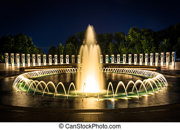 The National World War II Memorial Fountains at night at the...