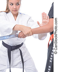 Martial arts self defense - Young athlete exercising with a...