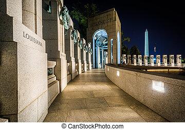 Walkway at the National World War II Memorial at night, at...